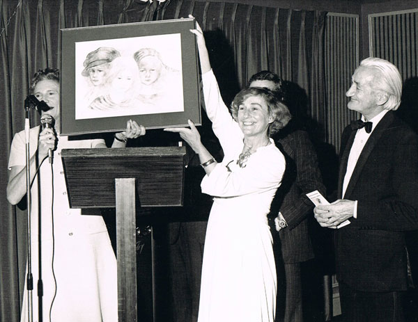 Photograph of Brownie presenting her work at the Dublin Exhibition in 1977